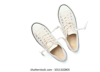 Top view image of New white sneakers isolated on white background