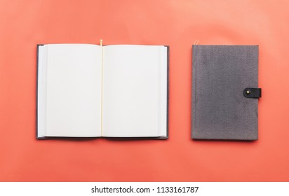 top view image of notebook on orange background.