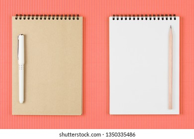 Top view image of  open notebook with pen on blank pages. school notebook on  spiral notepad on a table, flat lay