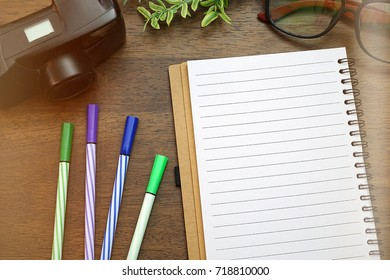 top view image of open notebook with blank pages on wooden background. ready for adding text or mock up