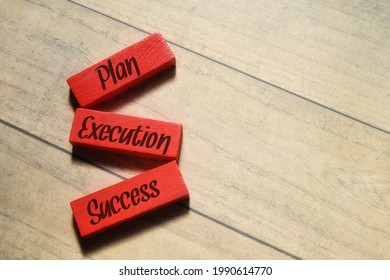 Top view image of red block with Plan Execution Success wording. Business concept