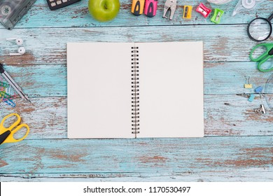 top view image of school supplies on wooden table. vintage filtered. education concept Flat lay.