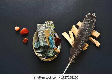 A top view image of a spiritual healing smudge kit bundle on a black background.
