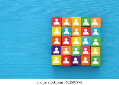 top view image of a  wood blocks with people icons , human resources and management concept.