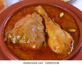 Top view of indian food, Closeup of chicken korma with cardamom. Pakistani qorma salan dish.