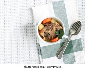 Top View Indonesian Sop Buntut or Oxtail Soup on White Bowl. Copy Space for text. Sop Buntut Made from Boiled Oxtail with Various Spice, Healthy and Delicious
