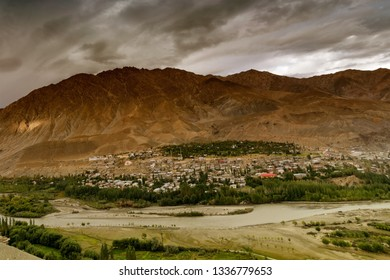 Top view of Indus river and Kargil City with Himalayan mountains in background, at Jammu and Kashmir, India. Kargil was the war zone of India Pakistan war in 1999. India won the war against Pakistan.