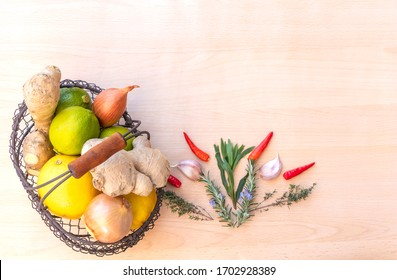 top view of an ingredients for cooking with fresh ginger, green lime, onion, chili, garlics, rosemary, thym isolated background with space.