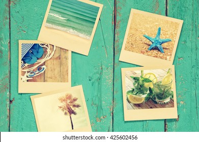 top view of instant photos album on wooden blue background. vintage filtered image