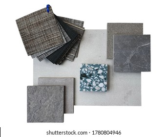 top view of interior material board contain concrete laminate ,stone tiles ,green terrazzo and vinyl floor tiles samples isolated on white background with clipping path.