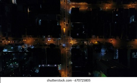 Top View of Intersection, Rooftops and illuminated streets