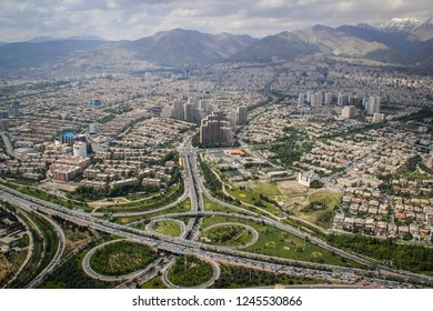 Top view of Iranian capital Tehran. Megapolis with road junctions