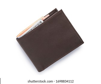Top view of isolated genuine leather brown with many banknotes on white background. Cash concept and clipping path photo.