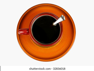 Top view of an isolated orange cup of coffee with little spoon