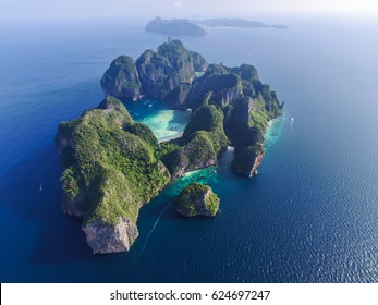 Top view of isolated rocky tropical island with turquoise water and white beach. Aerial view of Phi-Phi Leh island with Maya Bay and Pileh Lagoon. Krabi province, Thailand.