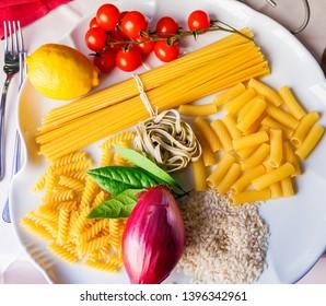 top view italian food ingredients - pasta, rice, tomatoes