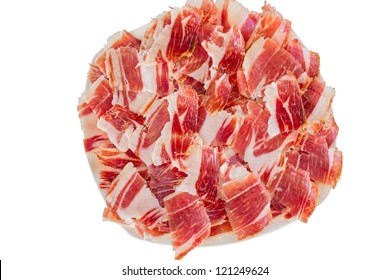 Top view of jabugo ham white plate with slices over white background