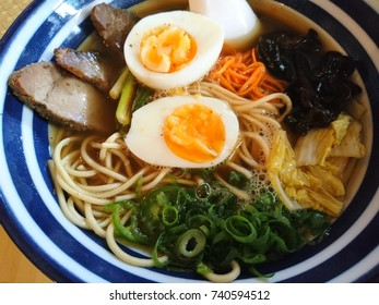 Top view of japanese ramen asian soup food noodles with egg.