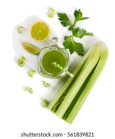 Top view of jar mug of celery juice and lime isolated on white background.