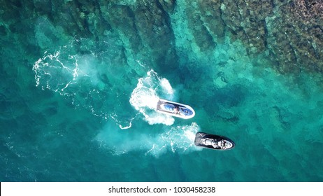 Top view of jet skis cruising in tropical sapphire clear waters