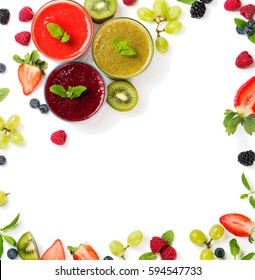 Top view of juices smoothie of summer fruits and berries - strawberry, raspberry, blueberry, blackberry, kiwi and grape isolated on white background.  Frame made from fruits.