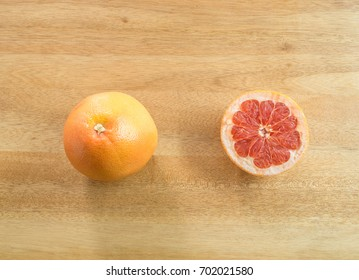 Top view - Juicy grapefruits on wooden background ( space and composition for text )