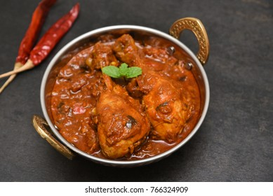 Top view Kadai chicken or Gosht Karahi curry roast hot and spicy gravy dish Mumbai, Delhi India. North Indian, Pakistani non-vegetarian cuisine prepared use Garam Masala. Popular side dish for chapati