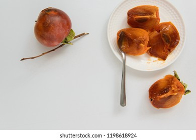 Top view of kaki fruits on white background, healthy eating concept, space for text