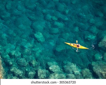 Top view of kayak boat oin shallow turquoise water of Ligurian sea, Italy