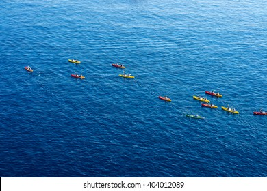 Top view of kayaking in the Adriatic sea. Kayaks aerial photo in Dubrovnik, Croatia.