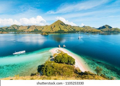 Top view of 'Kelor Island' in an afternoon before sunset with turquoise sea and tourist boats, Komodo Island (Komodo National Park), Labuan Bajo, Flores, Indonesia