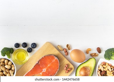 Top view of keto or ketogenic diet on white wooden background, low carb eating with high protein and good fat source