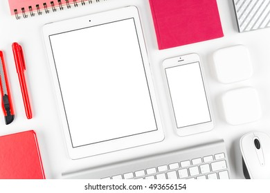 Top view: Keyboard, mouse, tablet computer and smartphone on white table background with space for text and copy space.