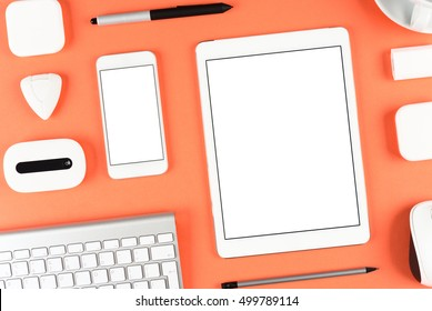 Top view: Keyboard tablet and smartphone on red table background with text space and copy space.