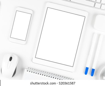 Top view: Keyboard, tablet, and smartphone on white table background with text space and copy space.