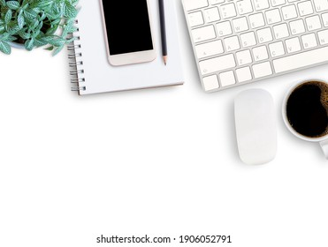 Top view with keyboard,mouse wireless,blank notebook or notepad,smartphone,fresh flower and cup of coffee on white background in office workplace. copy space for your design.