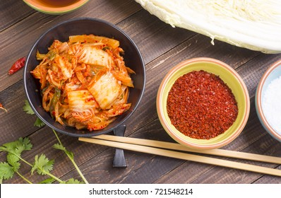 Top view of kimchi - korean fermented napa cabbage on wooden table
