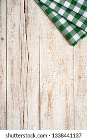 top view if kitche aged wooden board with green dishcloth, living background