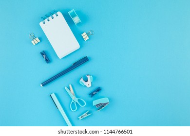 Top view knolling flat lay of workspace desk styled design school and office supplies with copy space turquoise blue color paper background minimal style. Template for feminine blog social media