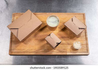top view of kraft paper food containers with meal for delivery