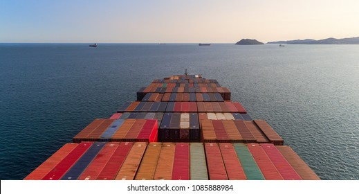 Top view of a laden container ship on a sunny afternoon.