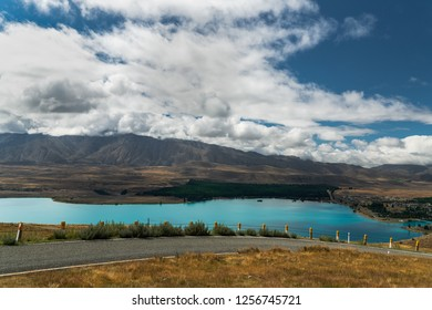 Top view of Lake Tekapo, dramatic cloudy sky, South Island New Zealand