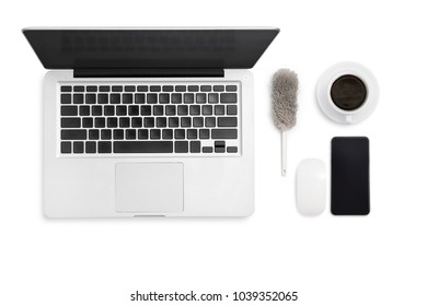 Top view of laptop computer isolated on white with clipping path. Working space and object (Laptop, smartphone, duster broom, coffee cup and mouse) for design template.