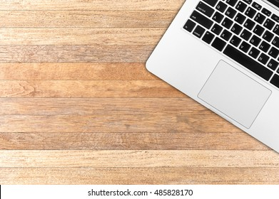 Top view laptop computer with mobile phone and tablet on office desk.Business template mock up for adding your text