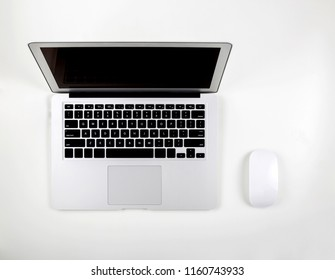 Top view of laptop computer with open display screen monitor and mouse isolated on white background, notebook or netbook with keyboard, communication technology concept.