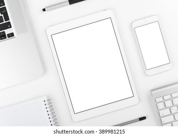Top view: Laptop tablet and smartphone alike on ipad and iphone on white table background with text space and copy space.