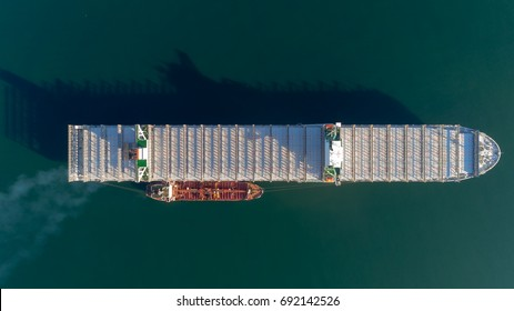 Top view of a large empty container ship and a tanker standing side by side.