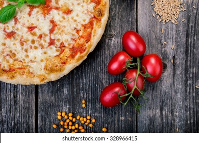 Top view of Large Pizza and rustic decor