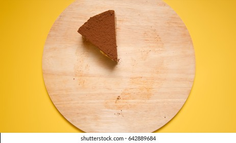 TOP VIEW: Last piece of Chocolate cake on a yellow background