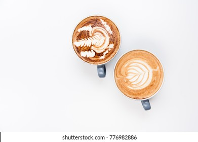Top view. Latte Art, coffee isolated on white background. Cup of latte, cappucino, cacao.